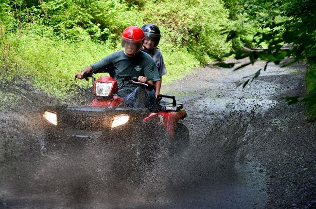 Riding through the mud on ATVs
