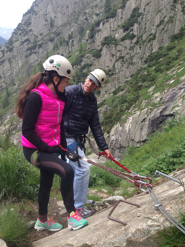 Steve Belkin demonstrates how to stay safely harnessed on the Via Ferrata.