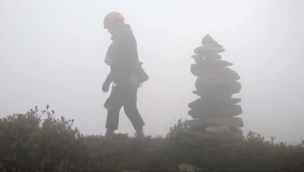 At the top, the fog has rolled in, making it difficult to see which way to go.