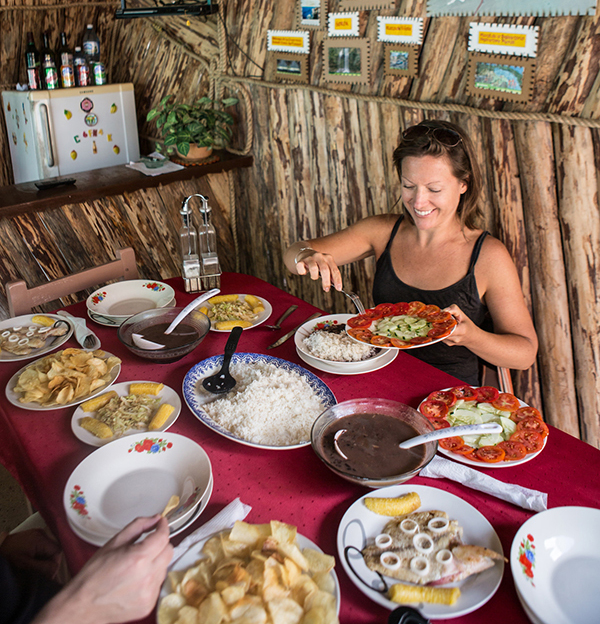 Lunch at a private-run casa particular in Viñales, Cuba. The meal included staples of the Cuban diet, including rice, beans, bananas,  veggies, potatoes and fish caught by the owner's father.